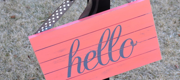 coral hello sign and stand